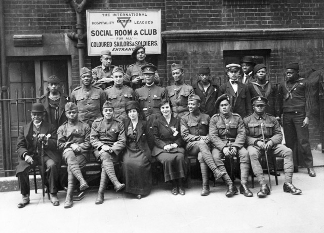 Photo of 18 black soldiers and women outside YMCA