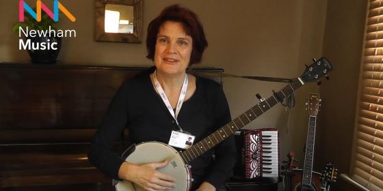 Music teacher smiling at camera