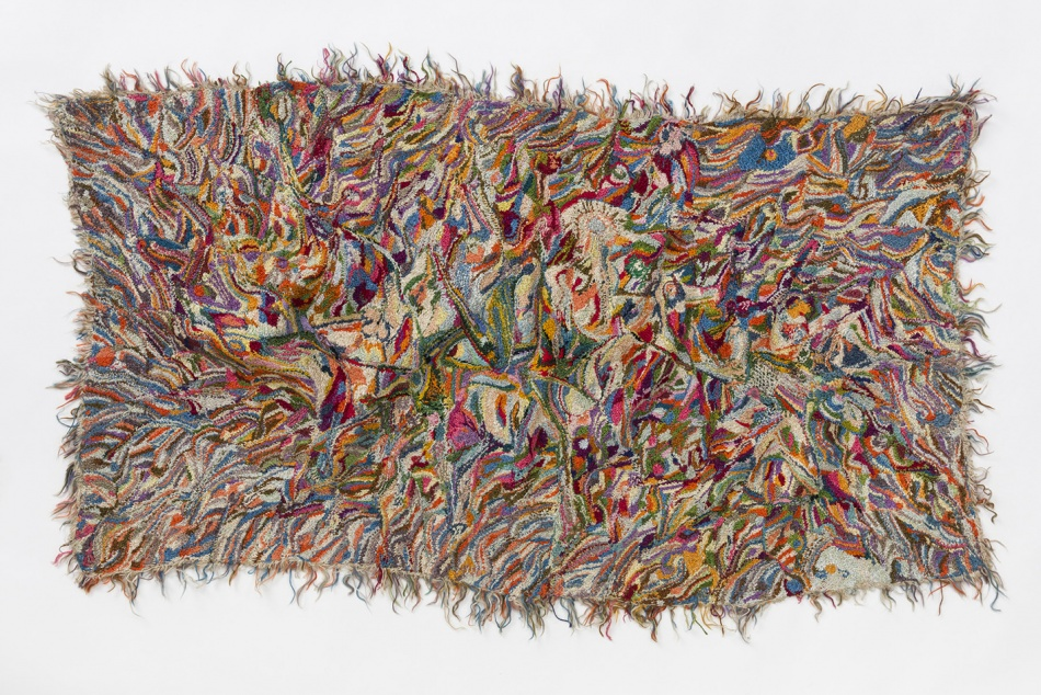 Multi coloured tapestry with frayed edges