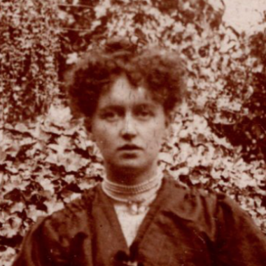 Sepia brown and white photo of Madge Gill