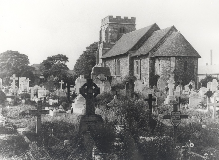 Black and white photo of exterior church and graveyard St Mary Magdalene East Ham Mary
